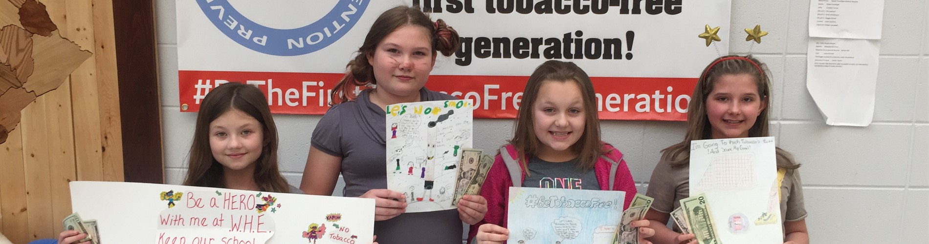 WHE students with winning posters.