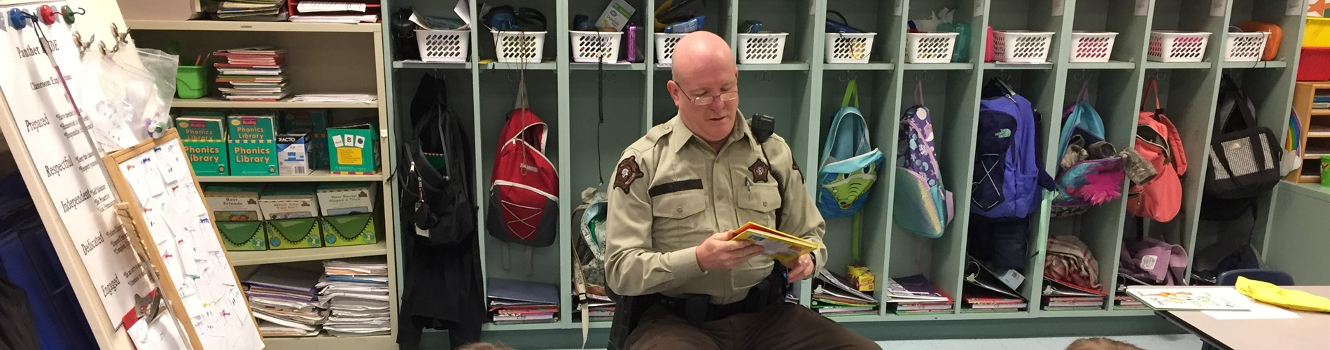 Deputy Blevins reads to a first grade classroom.