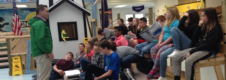 JPE beginning band students listen to Mr. Williams.